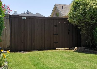 Dark Brown Stained Fence Plano