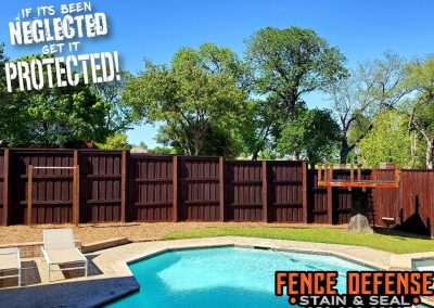 Dark Stained Fence By Backyard Pool