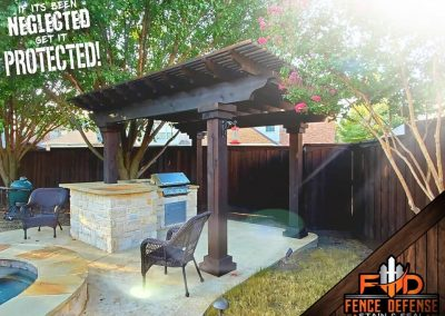 Dark Stained Pergola with Outdoor Kitchen