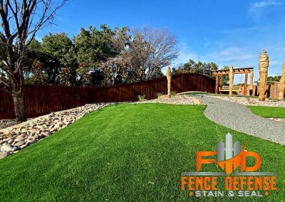 dark stained wood fence in Frisco