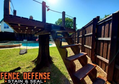 Professionally Stained Fence and Tree Fort